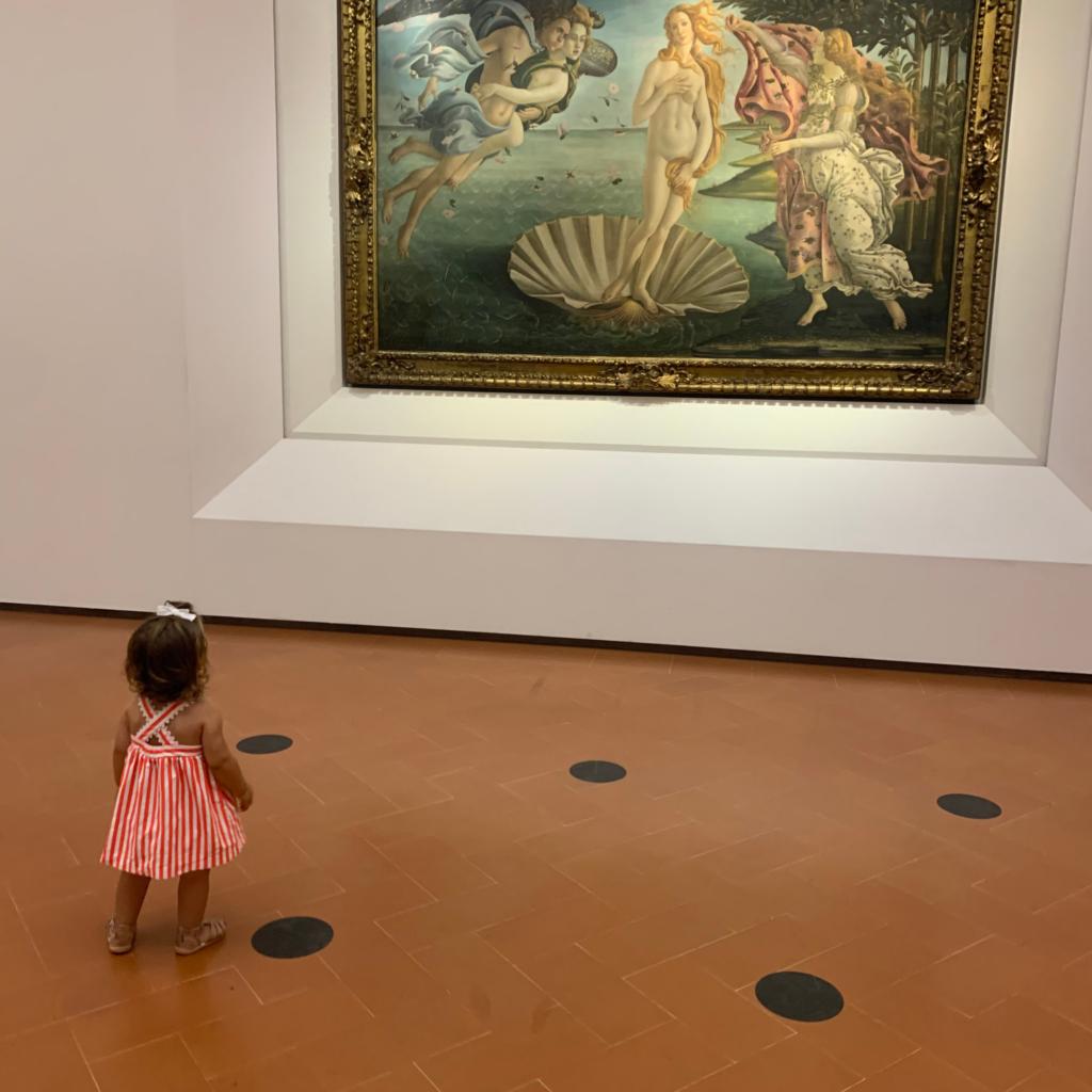 Bella Vita Travels' tiniest traveler exploring the Uffizzi by herself this summer